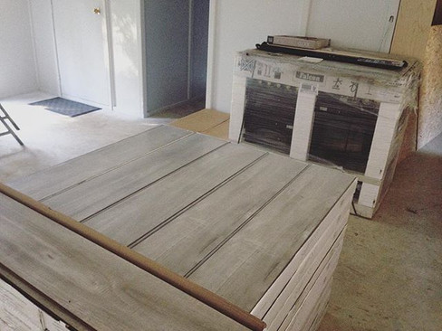 Farmhouse - new floors and stove arrived!