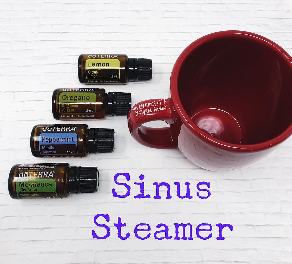 """red mug on counter with doTERRA oils next to it - """"sinus steamer"""""""