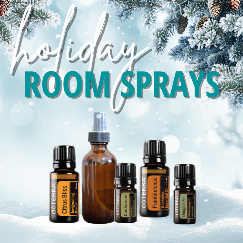 holiday room sprays - image of snowy scenery with edge of pine trees. Essential oils and spray bottle in the snow.