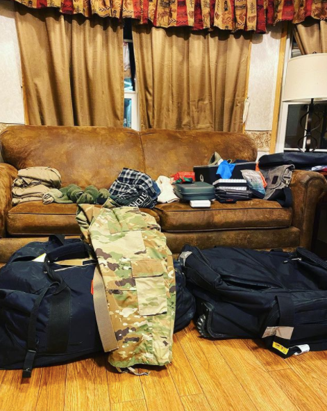 image of packed bags with army pants on top for deployment