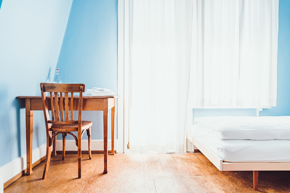 Bedroom with blue painting, sky blue colour