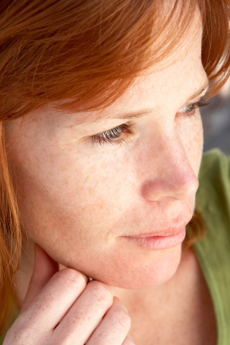 Young Redheaded Woman with Freckles