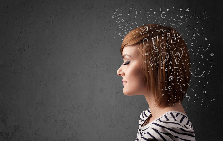 Young girl thinking with abstract icons