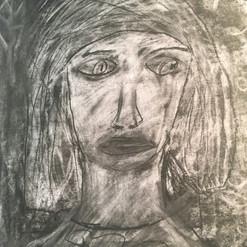 Self-portrait in charcoal