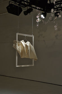 origami dress folded in a frame