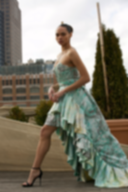 """<img src=""""green couture dress.png"""" alt=""""Model wears a green marbled dress with lots of ruffles and poses on a manhattan rooftop"""">"""