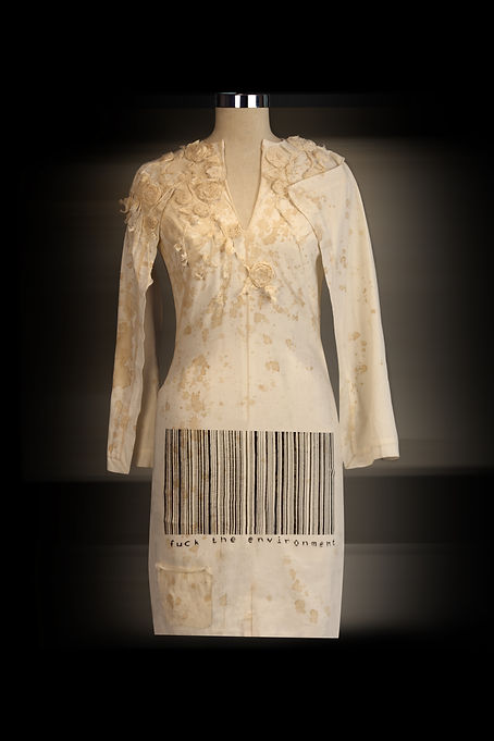 """<img src=""""barcode font dress .png"""" alt="""" A short dress with rosettes and the barcode font that says Fuck the Environment"""">"""