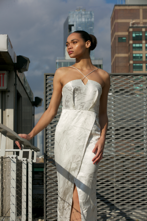 "<img src=""Front slit dress .png"" alt="" Model wears a white slit dress in marbled grey and white and poses on a rooftop in manhattan"">"