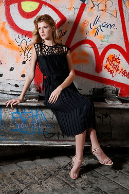 "<img src=""black cutwork dress.png"" alt=""white model with ginger hair wears a black dress with cut work embroidery at the neck and shoulders. she is against a red graffiti backdrop"">"
