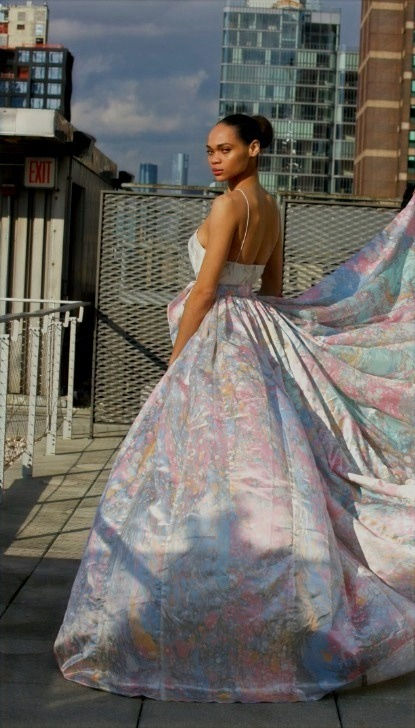 "<img src=""long flared skirt.png"" alt=""model wears a flared skirt with marbled fabric in various colors"">"