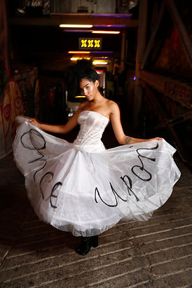 "<img src=""flared white skirt.png"" alt="" colored girl wears a sheer corset and a organza skirt which reads 'once upon a time'"">"