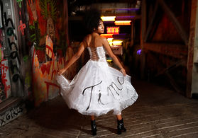 "<img src=""corset and hoop skirt.png"" alt="" afro american girl poses with a corset with back straps and hoop skirt in a dimly lit corridor"">"