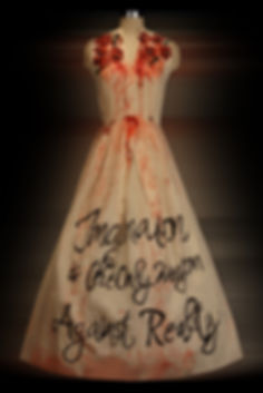 """<img src=""""long painted dress.png"""" alt="""" dress with flowers bleeding and words that say Imagination is the only weapon against reality"""">"""