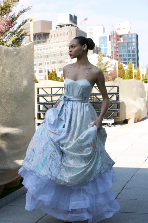 "<img src=""evening gown.png"" alt=""model wears a long strappy evening gown with layers of cancan on a rooftop in New York"">"