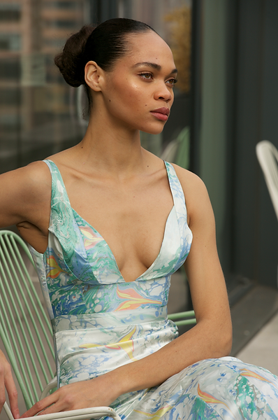"""<img src=""""blue dress.png"""" alt=""""model wears a blue marbled dress with flowers and sits in a manhatten balcony"""">"""