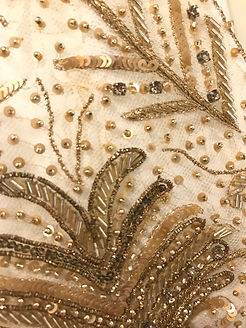 "<img src=""beaded f.png"" alt="" golden bead embroidery with sequences on sheer beige net fabric"">bric"