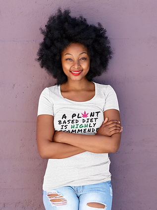t-shirt-mockup-of-a-happy-woman-with-natural-hair-leaning-on-a-purple-wall-38791-r-el2.png