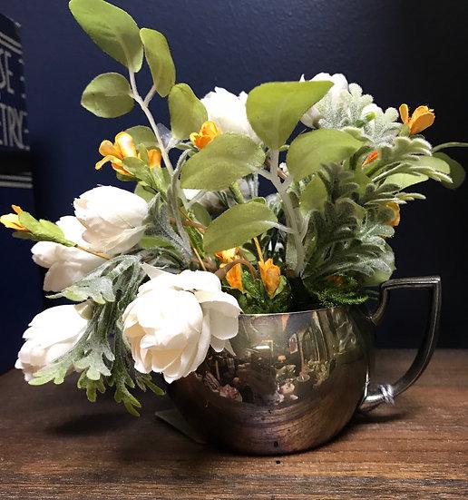 Silver creamer floral arrangement
