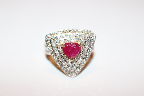 Sparkling Ruby surounded by white diamonds in 14K yellow gold