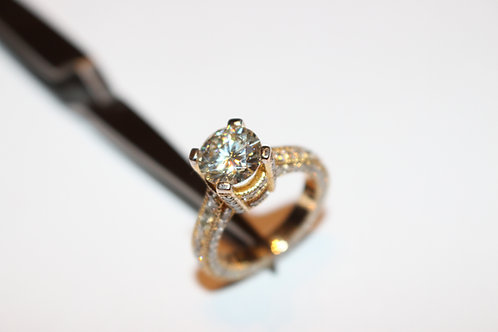 Brilliant centre Moisssanite and 104 white diamonds in 18 KT. yellow gold ring