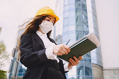 female-architect-with-construction-site-