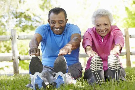 Senior African American Couple Exercising In Park.jpg