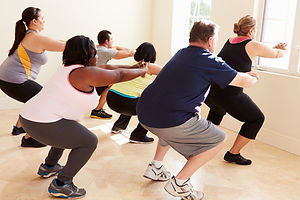 Fitness Instructor In Exercise Class For Overweight People.jpg