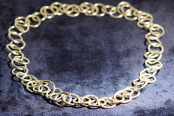 Beaten rings necklace