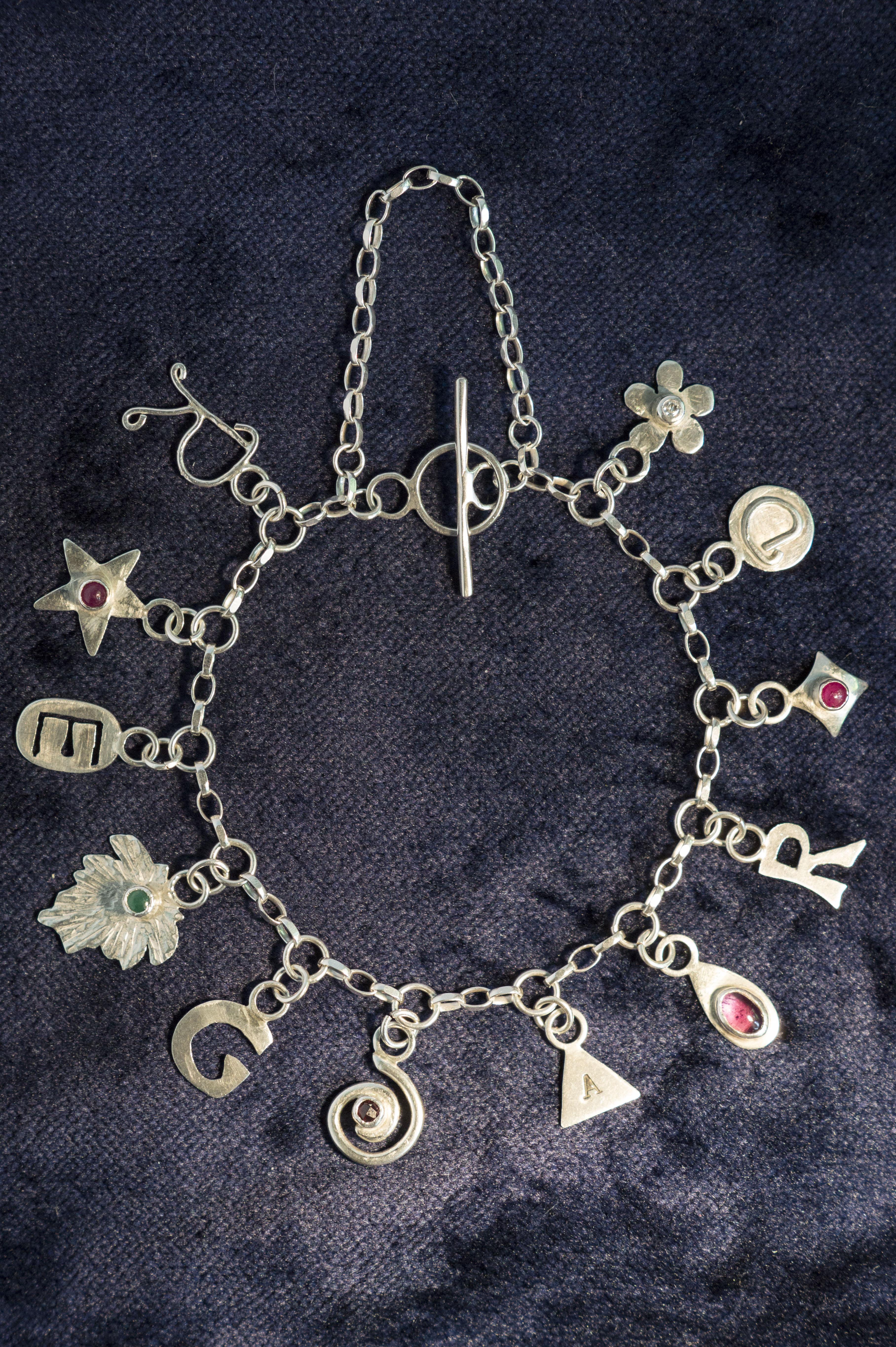 R.E.G.A.R.D Charm Bracelet