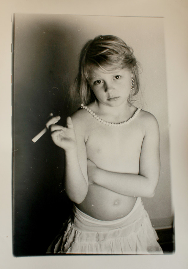 Child with rolled up paper