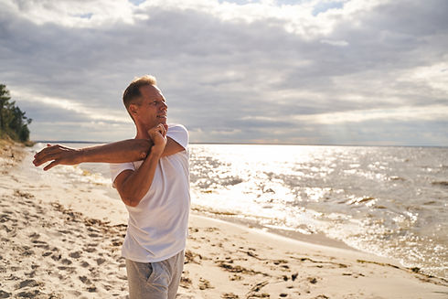 cheerful-man-training-outdoors-in-sunny-beach-2021-07-16-19-44-38-utc.jpg