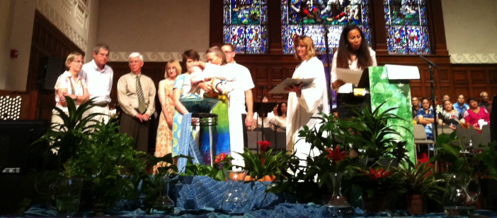 Mary Scifres with Bishop Mary Ann Swenson Baptizing.jpg