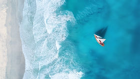 Yacht on the water surface from top view