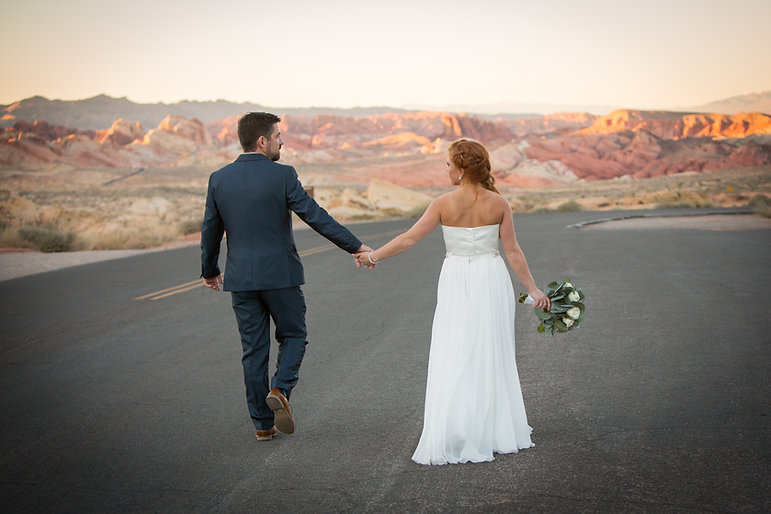 Bride And Groom On Desert Street At Valley Of Fire