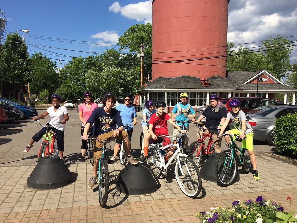 Students bicycling along the Erie Canal