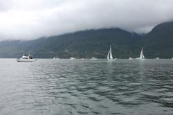 Sailpast under cloudy skies