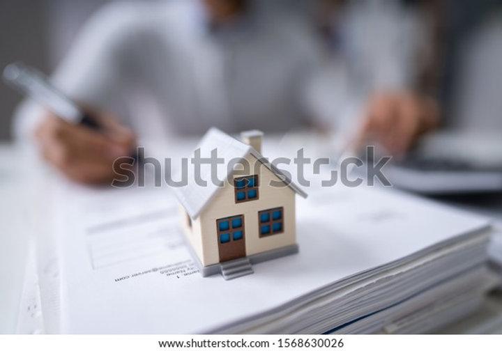 businessmans-hand-calculating-invoice-ho