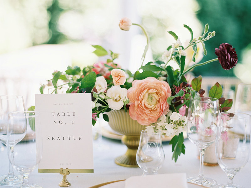 Colorful and elegant spring wedding centerpiece with peonies and ranunculas at Chateau Lill with flowers designed by Seattle Florist Botanique