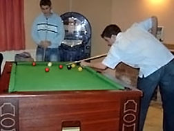 The Pool table, with juke box and dart's board in close proximity!