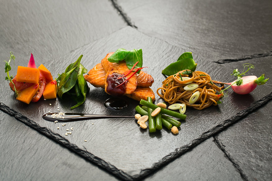 salmon with vegetables on black slate.jp