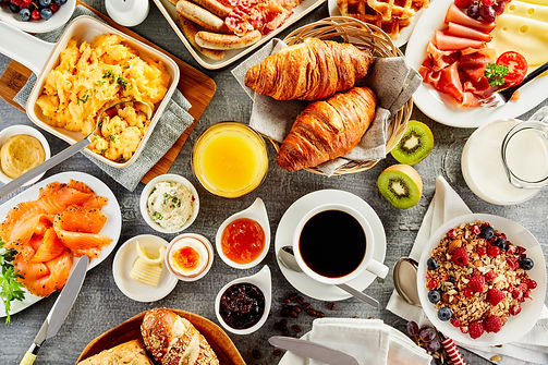 Large selection of breakfast food on a t