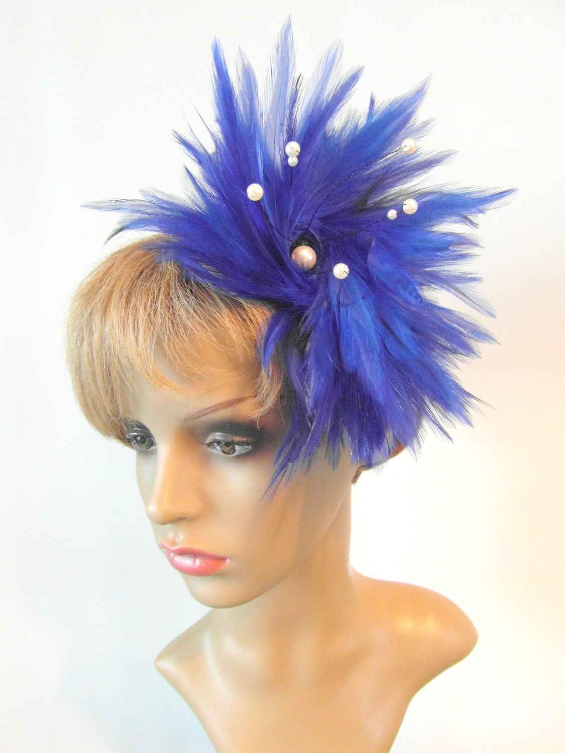 Blue feather fascinator with pearls