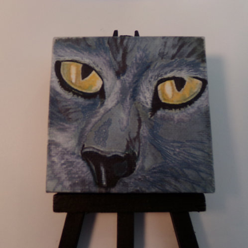 #223 old cats eyes 3x3 inch with easel