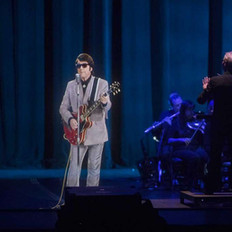Roy Orbison hologram accompanied by Fine Arts Strings musicians.