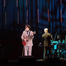 Wider shot of the Roy Orbison hologram  accompanied by our musicians.