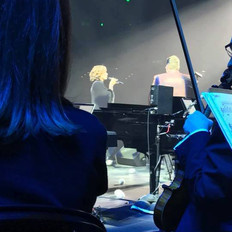 A view of Amy Grant from the orchestra provided by Fine Arts Strings.