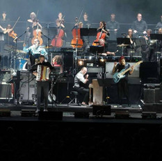 A shot of Hans Zimmer on piano with our violists, cellists and brass players on the second to last row.