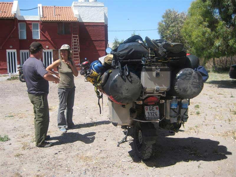 an absurdly overloaded adventure motorcycle camping motorcycle
