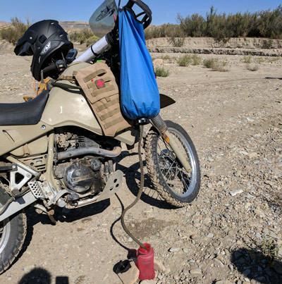 katadyn water purification gravity bag hanging on the legendary Kawasaki KLR 650