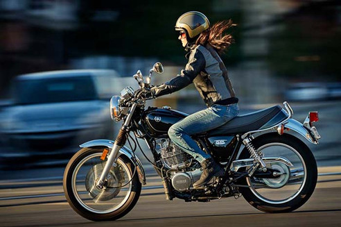 Great High Shutter Photo-Woman on Motorcycle